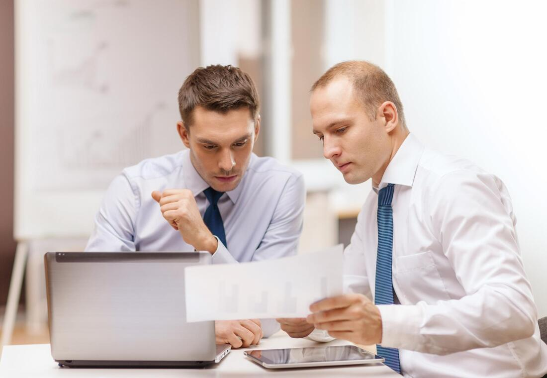 two employees working documents